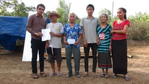 The Head of the Village told QLA that the local community had wanted to help this family for a long time but did not have the funds to do so and were very grateful that QLA could pay for the materials to build Vanh a new house. The Head of the Village allocated some land for the new house which was much closer to the village than the old house and would improve security. A few weeks later the land was cleared and Thoummy from QLA handed over the building materials to the village authorities and Ms Vanh's family.